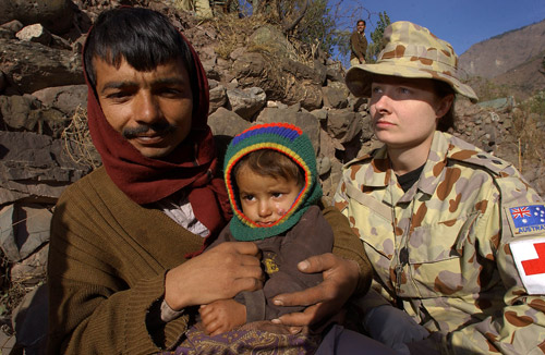 Courtesy Image: Commonwealth of Australia 2013 | Lieutenant Tamara Lee examines patients at the Australian medical centre in the earthquake-devastated town of Dhanni in Pakistan.