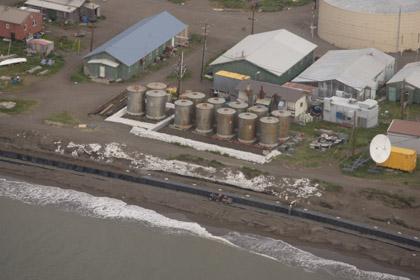 Photo Credit: Denali Commission   HESCO Seawall and Kivalina fuel tank farm.