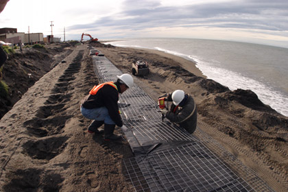 hoto Credit: Denali Commission   Working on the top layer of HESCO seawall in Kivalina.