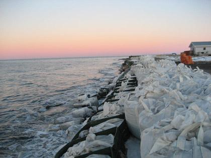 Photo Credit: Denali Commission    Supersacks on the damaged seawall in Kivalina.