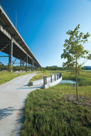 |Ground-level view of stormwater management area with walking bridge at MVIC.