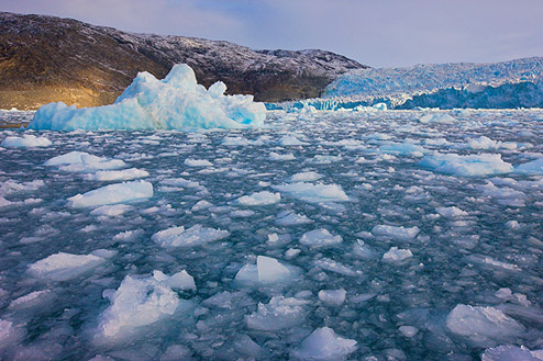 Jenny Ross |Brash ice formed from the wreckage of disintegrating sea ice and deteriorating icebergs turns the sea to slush at Greenland's Eqip Sermia Glacier. Outlet glaciers such as this one are conduits that move ice directly from land into the ocean, where it melts and raises sea level around the globe.