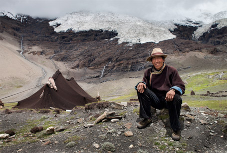 Phil Borges|Puchen, age 37, remembers the Nojin-Kangtsang glacier reached his tent when he was a boy. Shigatse Prefecture