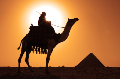 © iStockphoto.com/sculpies |A Bedouin at a pyramid.
