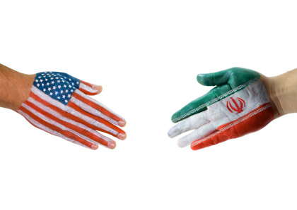 © iStockphoto.com/aytacbicer | An American and Iran handshake.