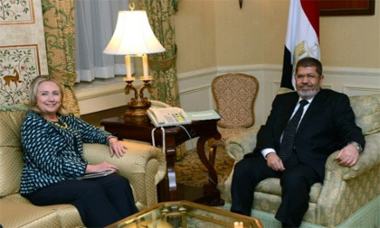 Photo Credit: State Department Secretary of State | Hillary Clinton meeting with Egyptian President Mohamed Morsi at the Waldorf Astoria Hotel.