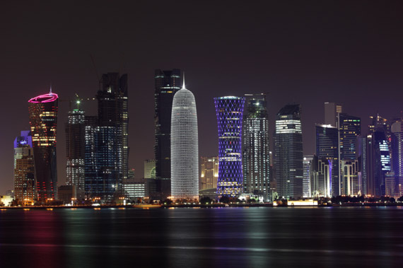 © iStockphoto.com/typhoonski | Doha skyline at night, Qatar, Middle East. Doha has been listed among the 2020 Global Sustainability Centers by the Ethisphere Institute.