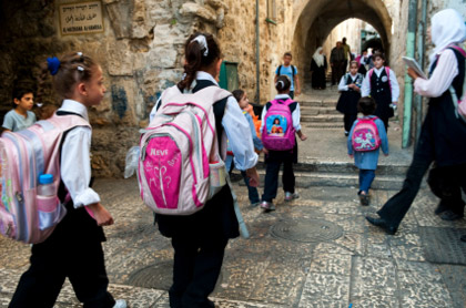 © iStockphoto.com/jcarillet Palestinian school children walk to school in the Muslim Quarter of the Old City of Jerusalem. Due to the Israeli Six-Day War (1967) the status of East Jerusalem is contentious.