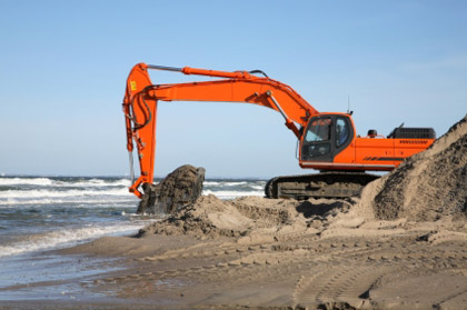 © iStockphoto.com/nielsquist | A digging project for sea-level rise and beach erosion control.