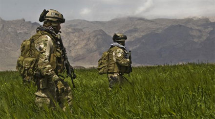 Photo Credit: Spc. Joseph A. Wilson|Special Forces Soldiers from the 3rd Special Forces Group patrol a field in the Gulistan district of Farah, Afghanistan with Afghan National Army commandos from the 207th Kandak, April 12, 2011.