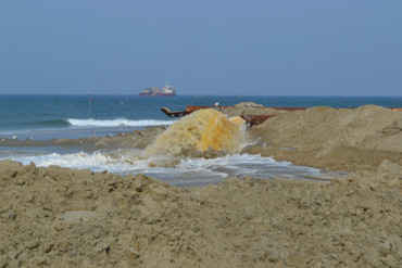 Photo by Robert Mickler | Beach nourishment to stabilize shoreline and protect coastal infrastructure.
