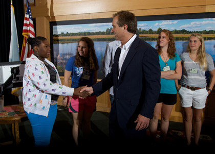 Photo Credit: Lawrenceville School in New Jersey, USA|Sc3 student fellow shaking hands with Robert F. Kennedy, Jr., at GSA's 2009 Student Climate & Conservation Congress.