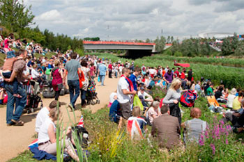 In 2012, London's Olympic Park visitors enjoyed river-edge ponds constructed to control stormwater.  Previously a polluted brownfield site, the area is being transformed into a sustainable, multi-use public park.  Photo credit:  Atkins.