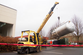 Photo Credit:  OSU | The large reactor vessel of HTTF arrived at the OSU Radiation Center in February 2013.  Made from special stainless steel, the vessel and other components were built by Harris Thermal, Inc., in Newburg, Oregon.