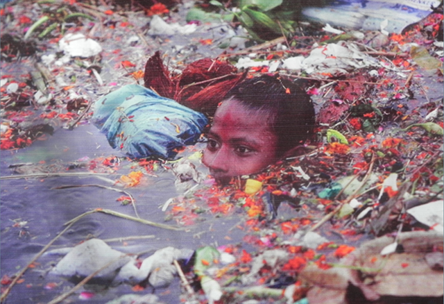Photo Courtesy Saikat Basu | A child collecting materials from dumped idol immersion.