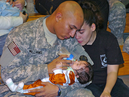 Photo courtesy US Army | A formerly deployed US service member reunited with his family.