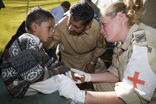 Photo courtesy NATO | A Dutch nurse reassures a little boy, a victim of the 2005 earthquake in Pakistan.